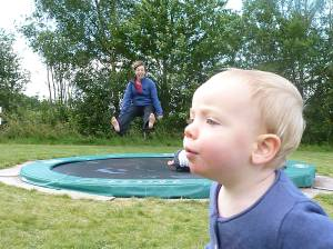 baby blowing trampoline
