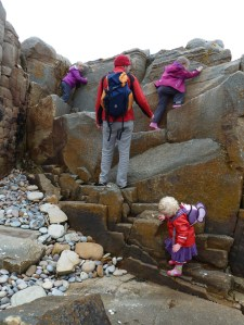 children scrambling bouldering rocks