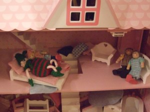 Dec 11: getting to know (!) the doll's house doll. Watched by a pair of smiling OAPs...