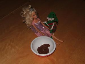Dec 19 - plying Barbie with chocolate orange segments and a rose. The smooth ol' devil!