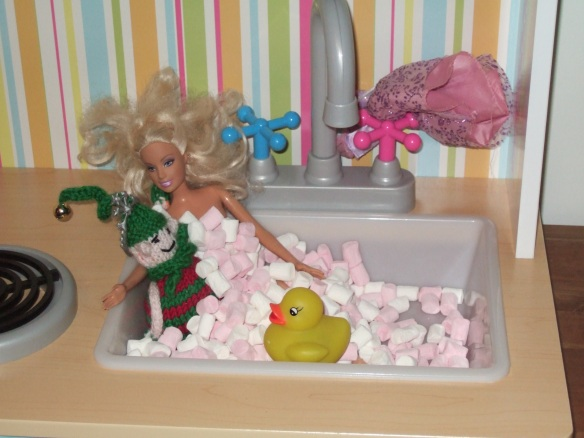 Dec 24 - wearing barbie's tiara in a bubble bath (the durrrty gurrrrl has stuffed her dress behind the taps!)