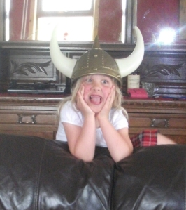 child in horned viking helmet