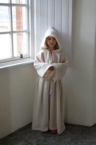 child in white monk's habit
