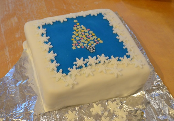 Christmas cake iced with tree and snowflakes