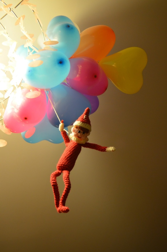 Elf on the Shelf with bunch of balloons