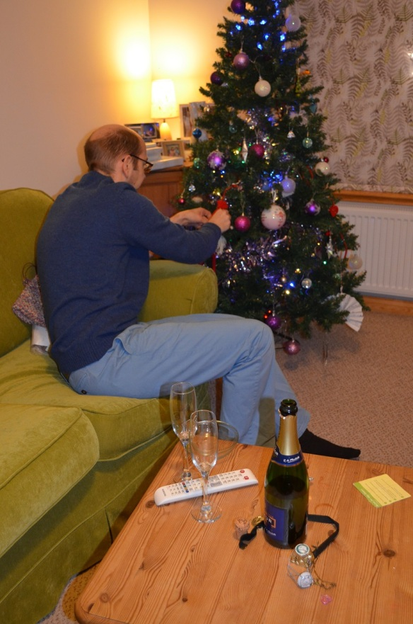 parent setting up elf on the shelf aided by alcohol