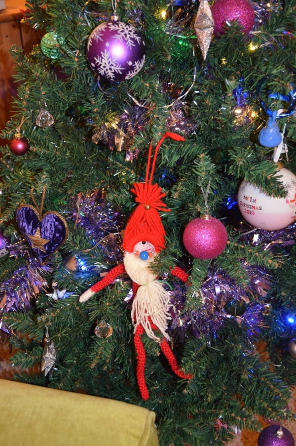 elf on the shelf hiding in a Christmas tree