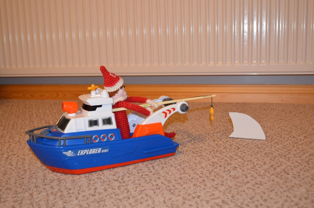 elf on the shelf sitting in a boat prank